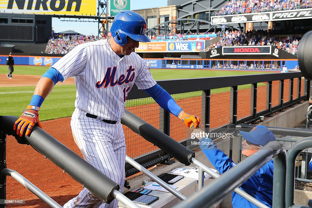 Asdrubal Cabrera #13 of the New York Mets is greeted by manager Terry Collins #10 after scoring on Michael Conforto #30 two-run double against the San Francisco Giants in the second inning at Citi Field on April 30, 2016 in the Flushing neighborhood of the Queens borough of New York City.