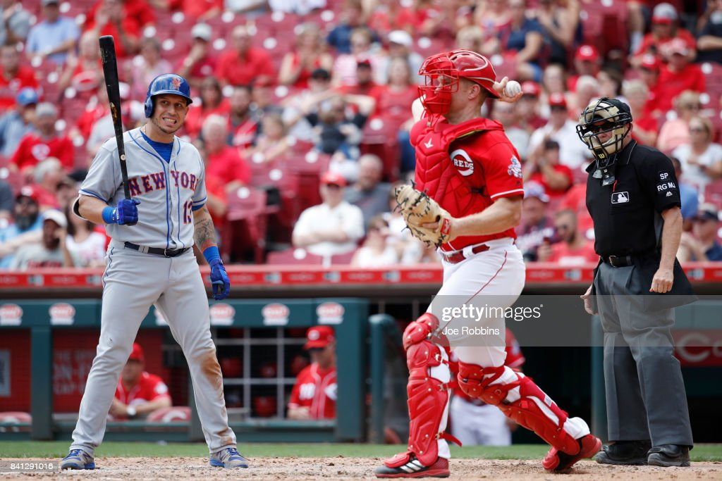 Asdrubal Cabrera #13 of the New York Mets reacts after being called out on strikes in the eighth inning against the Cincinnati Reds at Great American Ball Park on August 31, 2017 in Cincinnati, Ohio. The Reds defeated the Mets 7-2.
