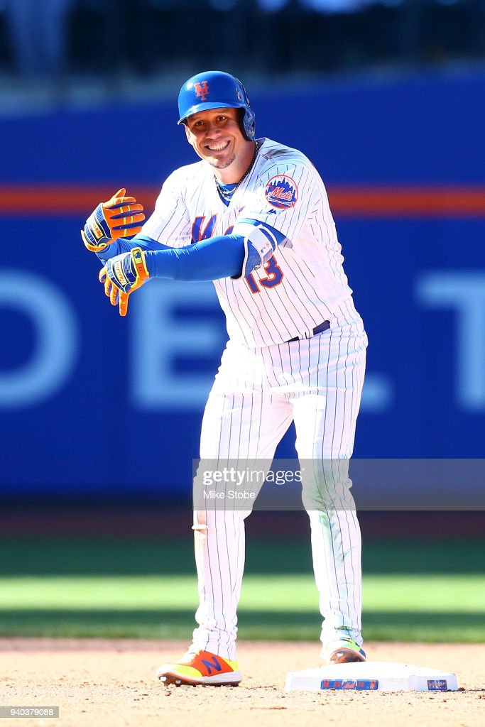 Asdrubal Cabrera #13 of the New York Mets reacts after hitting a two-run double in the eighth inning against the St. Louis Cardinals at Citi Field on March 31, 2018 in the Flushing neighborhood of the Queens borough of New York City.