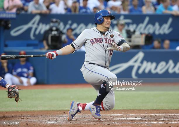Asdrubal Cabrera of the New York Mets reacts as he fouls a ball off his leg in the fifth inning during MLB game action against the Toronto Blue Jays...