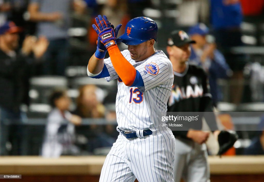 Asdrubal Cabrera #13 of the New York Mets reacts as he scores the game tying run in the seventh inning past Brad Ziegler #29 of the Miami Marlins at Citi Field on May 5, 2017 in the Flushing neighborhood of the Queens borough of New York City.
