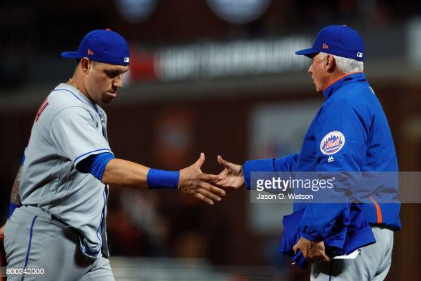 Asdrubal Cabrera of the New York Mets shakes hands with manager Terry Collins after the game against the San Francisco Giants at ATT Park on June 23...