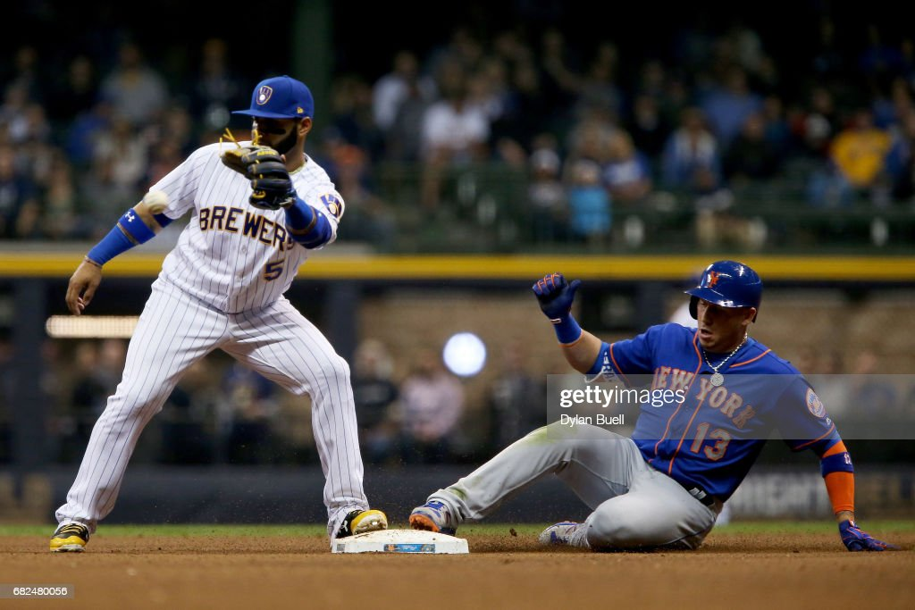 Asdrubal Cabrera #13 of the New York Mets slides into second for a double past Jonathan Villar #5 of the Milwaukee Brewers in the sixth inning at Miller Park on May 12, 2017 in Milwaukee, Wisconsin.