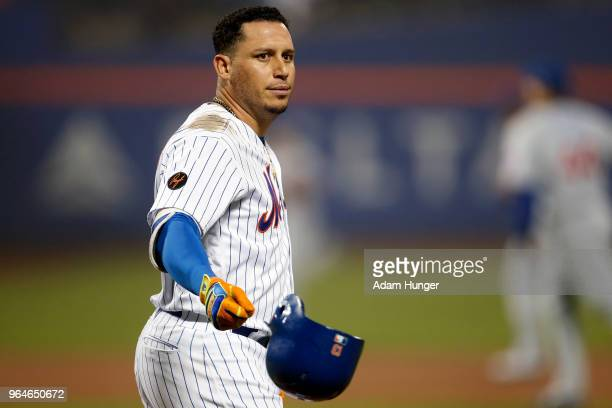 Asdrubal Cabrera of the New York Mets throws his batting helmet after flying out against the Chicago Cubs during the eighth inning at Citi Field on...