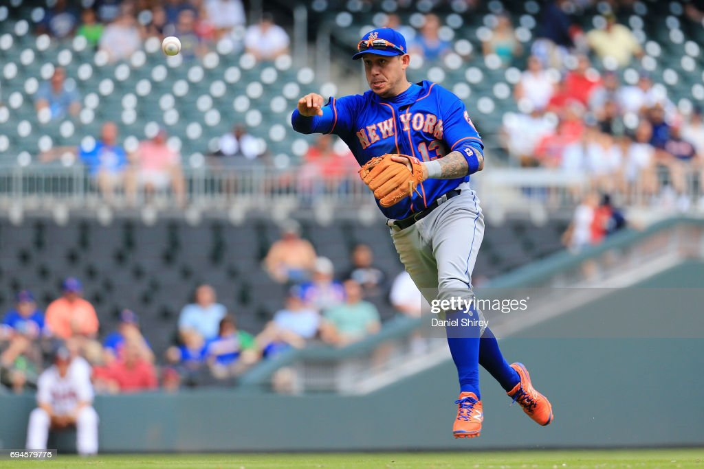 Asdrubal Cabrera #13 of the New York Mets throws to first for an out during the eighth inning against the Atlanta Braves at SunTrust Park on June 10, 2017 in Atlanta, Georgia.