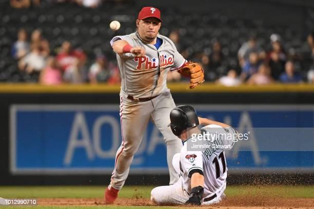 Asdrubal Cabrera of the Philadelphia Phillies turns the double play over AJ Pollock of the Arizona Diamondbacks at Chase Field on August 7 2018 in...