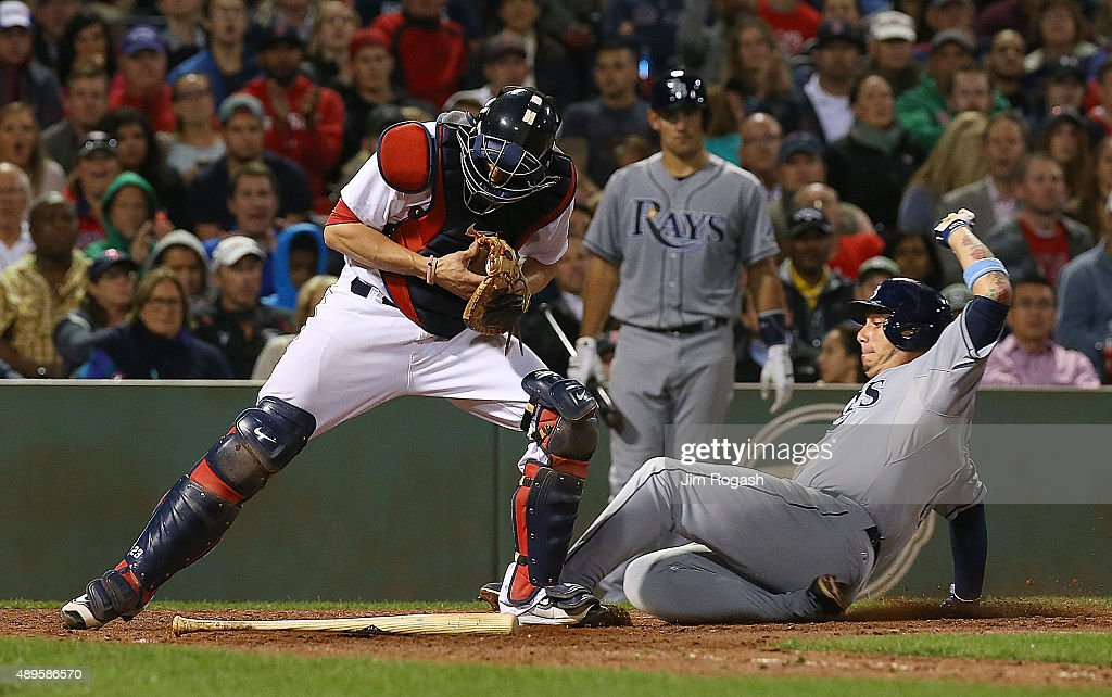 Asdrubal Cabrera #13 of the Tampa Bay Rays is out at the plate as Blake Swihart #23 of the Boston Red Sox steps on the plate in the seventh inning at Fenway Park on September 22, 2015 in Boston, Massachusetts.