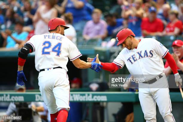 Asdrubal Cabrera of the Texas Rangers congratulates Hunter Pence for hitting a solo home run in the second inning against the Baltimore Orioles at...