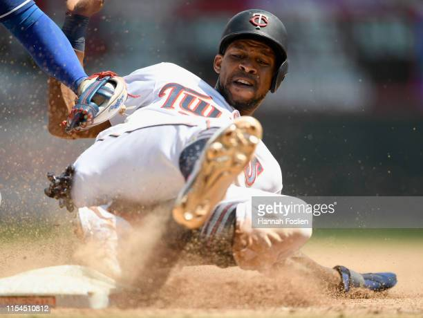 Asdrubal Cabrera of the Texas Rangers tags out Byron Buxton of the Minnesota Twins at third base to complete a double play during the fifth inning of...