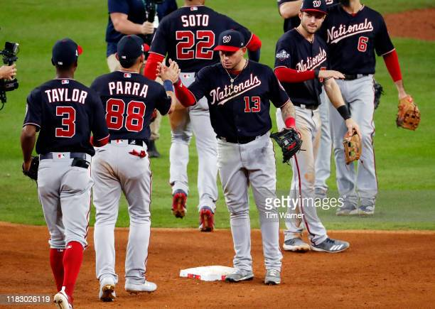 Asdrubal Cabrera of the Washington Nationals celebrates with his teammates after their 123 win over the Houston Astros in Game Two of the 2019 World...