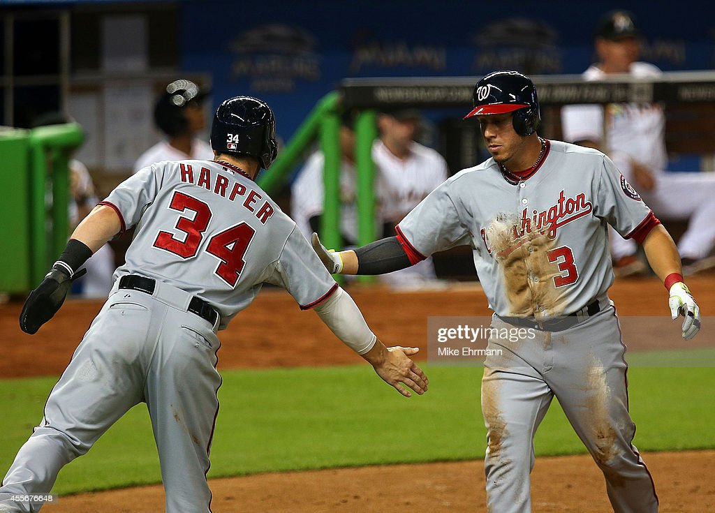 Asdrubal Cabrera #3 of the Washington Nationals is congratulated by Bryce Harper #34 after scoring during a game against the Miami Marlins at Marlins Park on September 18, 2014 in Miami, Florida.