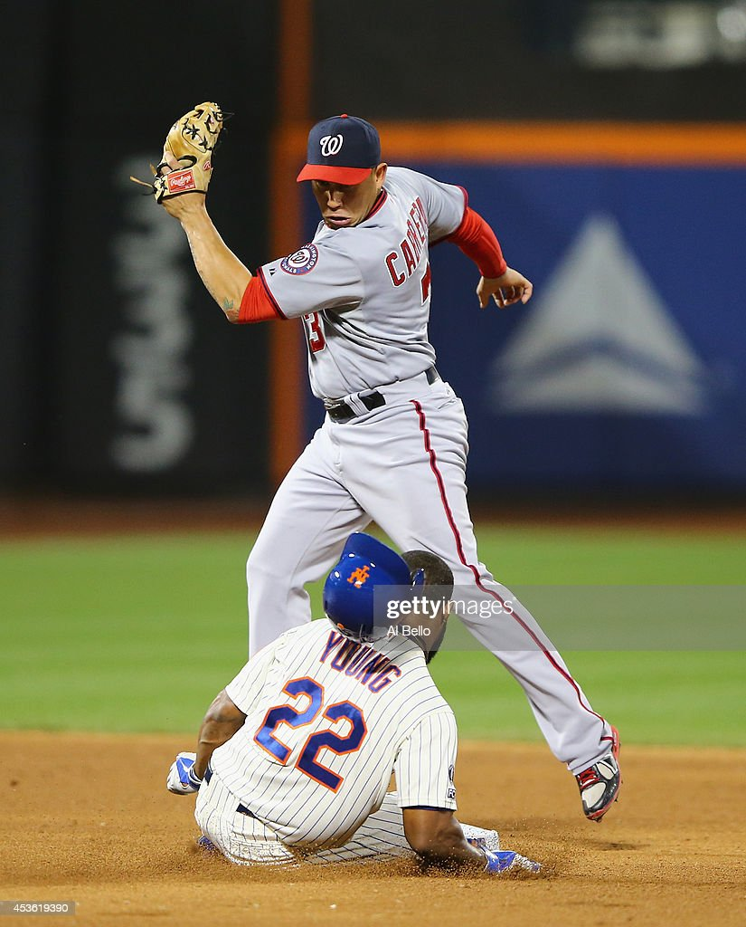 Asdrubal Cabrera #3 of the Washington Nationals is late with the tag against Eric Young Jr. #22 of the New York Mets who slides in with a double in the sixth inning during their game on August 14, 2014 at Citi Field in the Flushing neighborhood of the Queens borough of New York City.