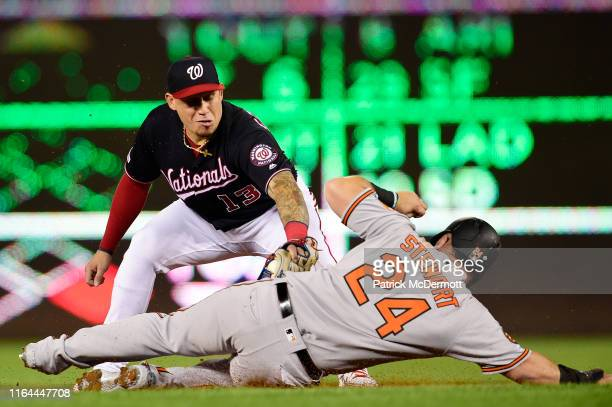 Asdrubal Cabrera of the Washington Nationals tags DJ Stewart of the Baltimore Orioles out at second base as he turns a double play in the eighth...