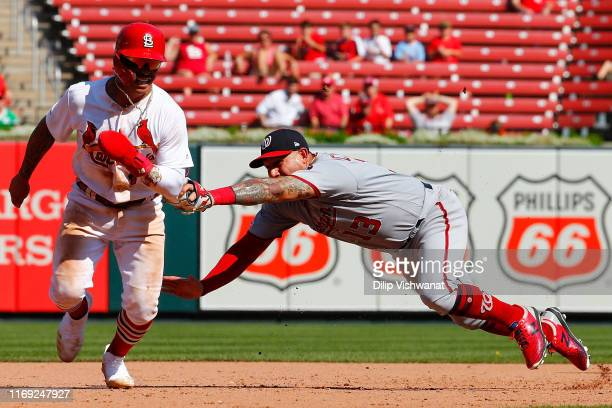 Asdrubal Cabrera of the Washington Nationals tags Kolten Wong of the St. Louis Cardinals for an out in the eighth inning at Busch Stadium on...
