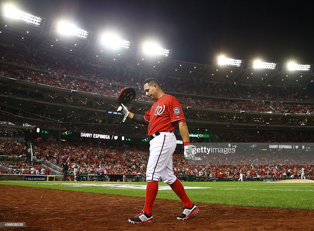 Asdrubal Cabrera #3 of the Washington Nationals walks to the dugout after grounding out in the ninth inning against the San Francisco Giants during Game One of the National League Division Series at Nationals Park on October 3, 2014 in Washington, DC.