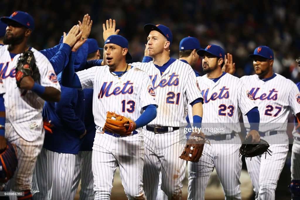 Asdrubal Cabrera #13, Todd Frazier #21, Adrian Gonzalez #23, and Jeurys Familia #27 of the New York Mets celebrate a 6-5 win against the Milwaukee Brewers during their game at Citi Field on April 13, 2018 in New York City.