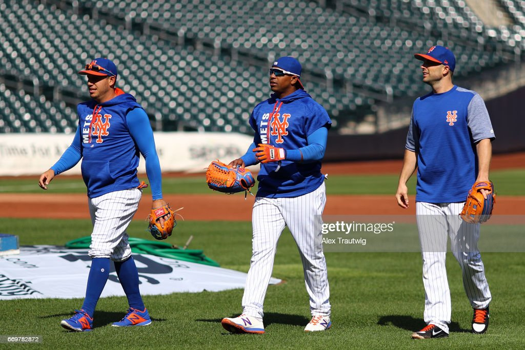 Asdrubal Cabrera #13, Yoenis Cespedes #52, and David Wright #5 of the New York Mets walk on the field during batting practice ahead of the game between the Atlanta Braves and New York Mets at Citi Field on Monday April 3, 2017 in the Queens borough of New York City.