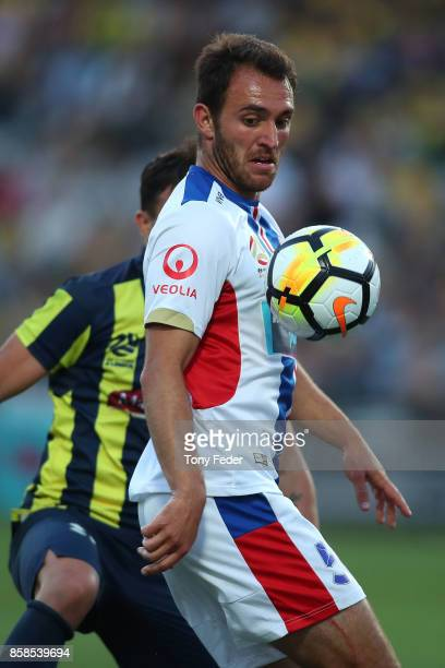 Asdrubal of the Mariners and Benjamin Kantarovski of the jets contest the ball during the round one A-League match between the Central Coast Mariners...