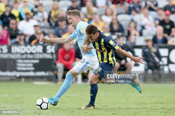 Asdrubal of the Mariners attempts to score a goal with Michael Jakobsen of Melbourne City in defence during the round 16 ALeague match between the...
