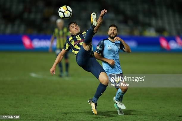 Asdrubal of the Mariners contests the ball against Michael Zullo of Sydney FC during the round six ALeague match between the Central Coast Mariners...