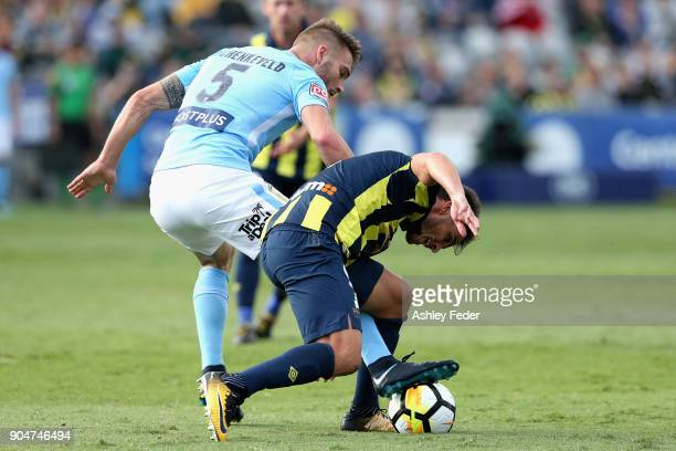Asdrubal of the Mariners is contested by Ben Schenkeveld of Melbourne City during the round 16 ALeague match between the Central Coast Mariners and...