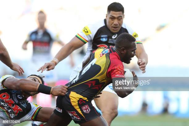 Ase Boas of the Hunters is tackled during the 2017 State Championship Final between the Penrith Panthers and Papua New Guinea Hunters at ANZ Stadium...