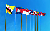 Asean Economic Community flags on the blue sky background.