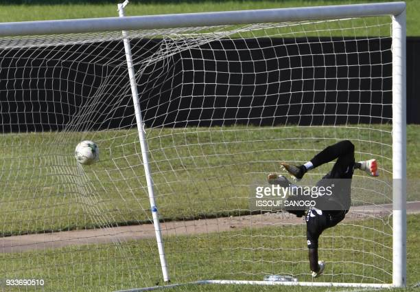 TOPSHOT Asec's goalkeeper Abdoul Karim Cisse concedes a goal during the CAF Champions league football match between Asec d'Abidjan and Zesco United...