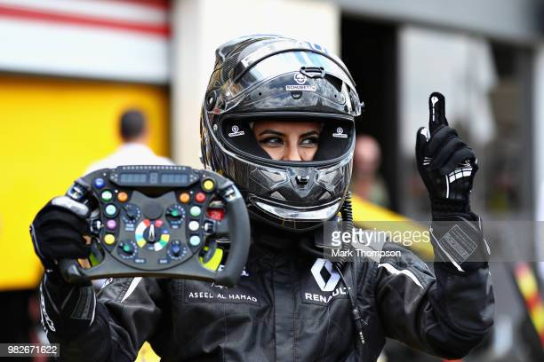 Aseel AlHamad of Saudi Arabia poses for a photo after driving the 2012 Renault F1 car before the Formula One Grand Prix of France at Circuit Paul...