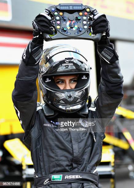 Aseel Al-Hamad of Saudi Arabia poses for a photo after driving the 2012 Renault F1 car before the Formula One Grand Prix of France at Circuit Paul...