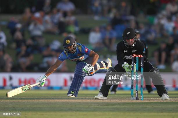 Asela Gunaratne of Sri Lanka Ash Sodhi of the New Zealand Blackcaps run out by Tim Seifert of the New Zealand Blackcaps during game two in the One...