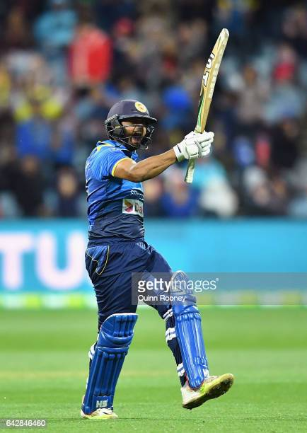 Asela Gunaratne of Sri Lanka celebrates hitting the winning runs to win the second International Twenty20 match between Australia and Sri Lanka at...