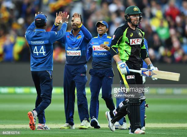 Asela Gunaratne of Sri Lanka is congratulated by team mates after getting the wicket of Ben Dunk of Australia during the second International...