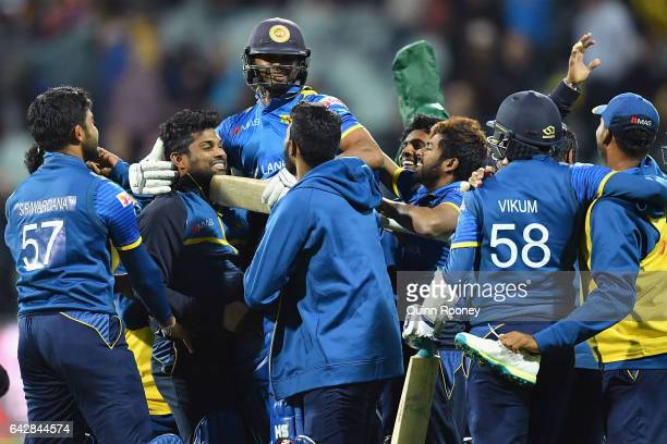 Asela Gunaratne of Sri Lanka is congratulated by team mates after hitting the winning runs to win the second International Twenty20 match between...