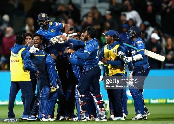 Asela Gunaratne of Sri Lanka is congratulated by team mates after hitting the winning runs to win the second International Twenty20 match between...