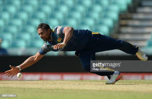 Asela Gunaratne of Sri Lanka stops the ball during the ICC Champions Trophy Warm-up match between Australia and Sri Lanka at the Kia Oval cricket...