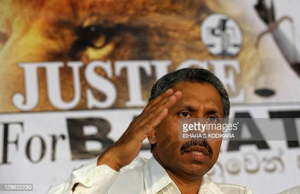 Asela Premachandra brother of slain former Sri Lankan ruling party lawmaker Bharatha Premachandra speaks to reporters demanding an independent...