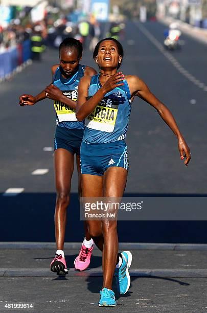 Aselefech Mergia Medessa of Ethiopia celebrates winning the Women's marathon during the Standard Chartered Dubai Marathon on January 23 2015 in Dubai...
