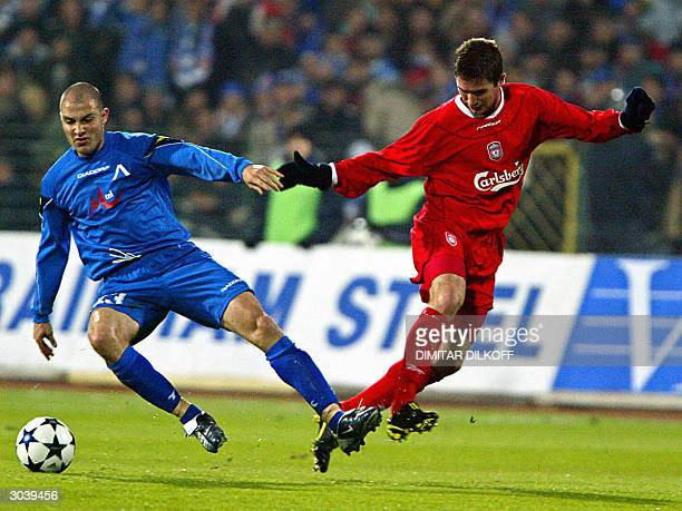 Asen Bukarev from Levski Sofia challenges Harry Kewell from Liverpool during their UEFA Cup third round second leg football match in Sofia 03 March...