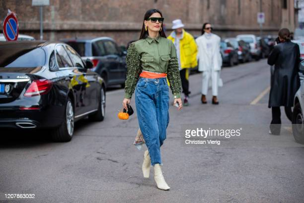 Asena Sarıbatur is seen wearing green button shirt, denim jeans, Prada micro bag outside Sportmax during Milan Fashion Week Fall/Winter 2020-2021 on...