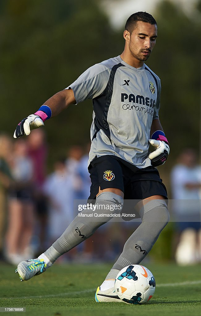 Asenjo of Villarreal in action during a friendly match between Villarreal CF and Granada FC at La Manga Club on August 03, 2013 in La Manga, Spain.