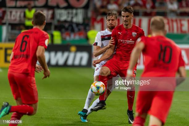 Asger Soerensen of FC Nuernberg and Gabriel Weiss of FC Ingolstadt battle for the ball during the DFB Cup first round match between SV Sandhausen and...