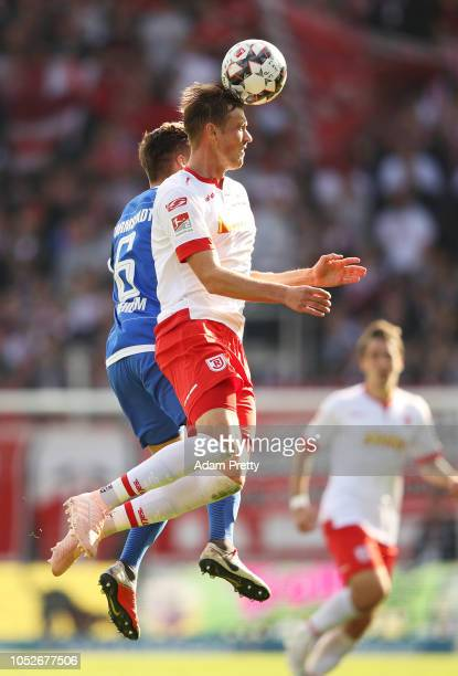 Asger Soerensen of Jahn Regensburg heads the ball in front of Marvin Mehlem of SV Darmstadt 98 during the Second Bundesliga match between SSV Jahn...