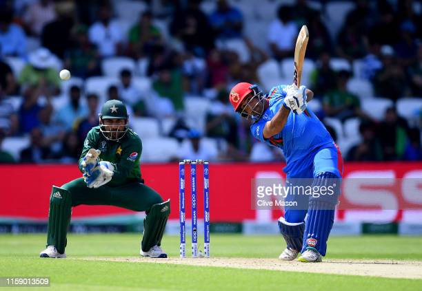 Asghar Afghan of Afghanistan in action batting as Sarfaraz Ahmed of Pakistan looks on during the Group Stage match of the ICC Cricket World Cup 2019...