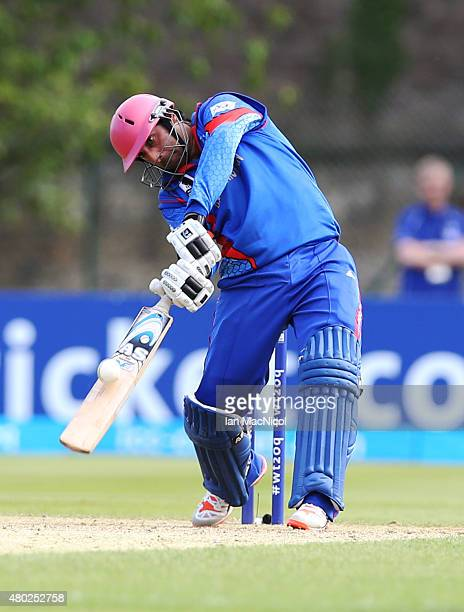 Asghar Stanikai of Afghanistan hits a six to secure victory during the ICC World Twenty20 India Qualifier between UAE and Afghanistan at the Grange...
