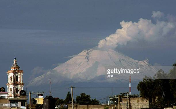 Ash and smoke spew from Popocatepetl volcano in Panotla community on Tlaxcala Mexico on August 26 2012 According to a report by the National Center...