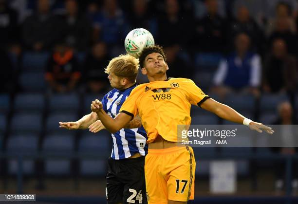 Ash Baker of Sheffield Wednesday and Morgan GibbsWhite of Wolverhampton Wanderers during the Carabao Cup Second Round match between Sheffield...
