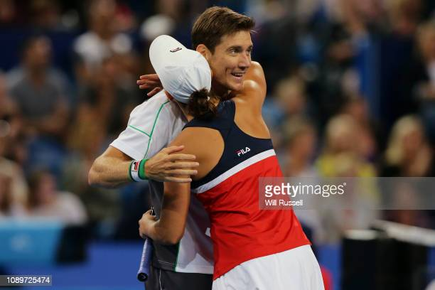 Ash Barty and Matt Ebden of Australia embrace after defeating Angelique Kerber and Alexander Zverev of Germany in the mixed doubles match during day...