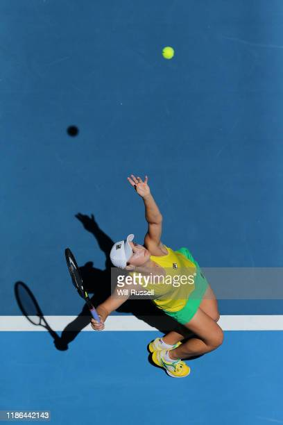 Ash Barty of Australia serves to Caroline Garcia of France in the 2019 Fed Cup Final tie between Australia and France at RAC Arena on November 09...