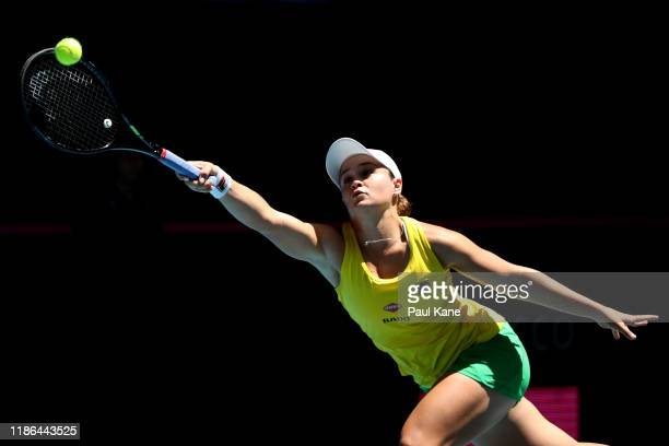 Ash Barty of Australia stretches to play a forehand during her singles match against Caroline Garcia of France in the 2019 Fed Cup Final tie between...